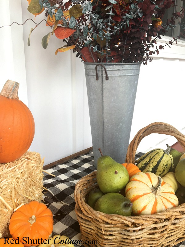 Pumpkins and pears are part of A Festive Fall on the Front Porch. www.redshuttercottage.com