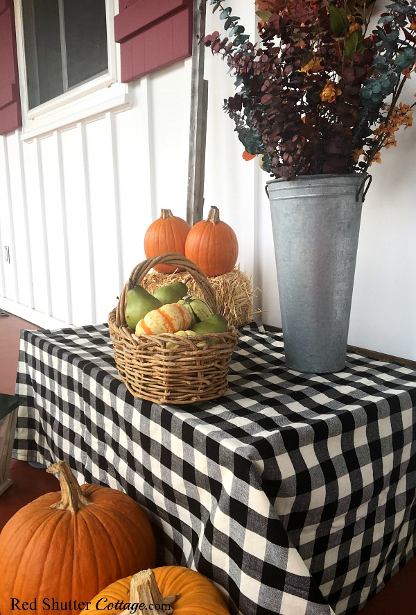 Black and white buffalo check anchors this grouping of a Festive Fall on the Front Porch. www.redshuttercottage.com