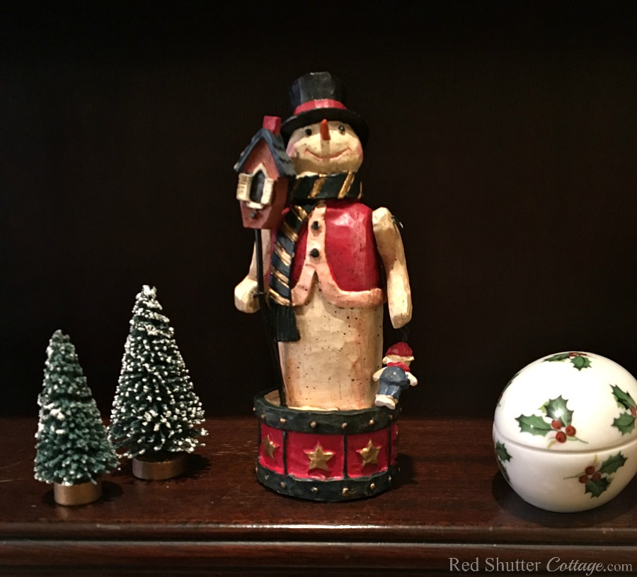 This snowman next to the Limoges Christmas egg is part of our entry into the 2018 Christmas Living Room. www.redshuttercottage.com