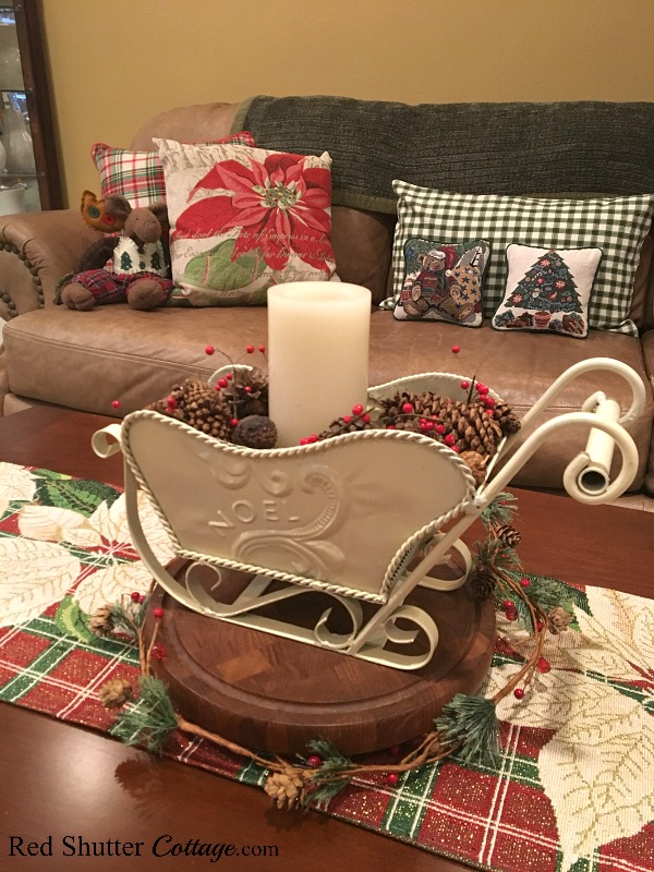 The plaid in the coffee table runner works with the plaid pillows on the couch in the 2018 Christmas Living Room. www.redshuttercottage.com