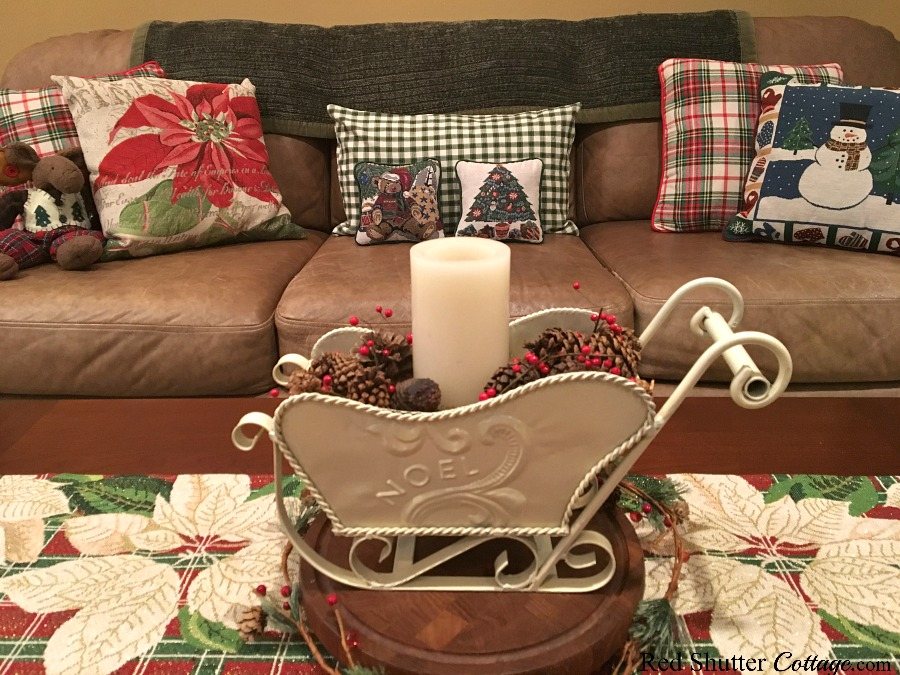 The plaid runner on the coffee table works with the plaid pillows on the couch. www.redshuttercottage.com