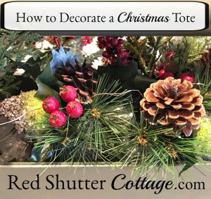 Pine cones, berries and holly leaves are all part of how to decorate a Christmas Tote. www.redshuttercottage.com