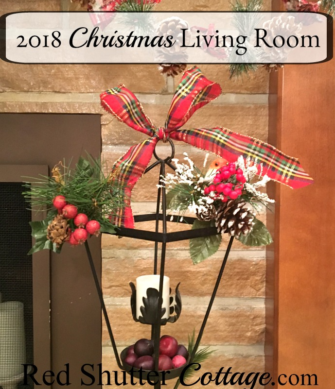 This wrought iron lamp post comes out every year for Christmas, including the year's 2018 Christmas Living Room. www.redshuttercottage.com