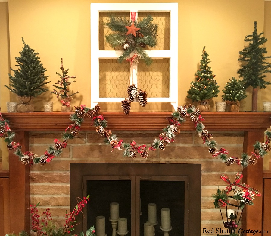 A front view of the fireplace and mantel, all dressed up for the 2018 Christmas Living Room. www.redshuttercottage.com