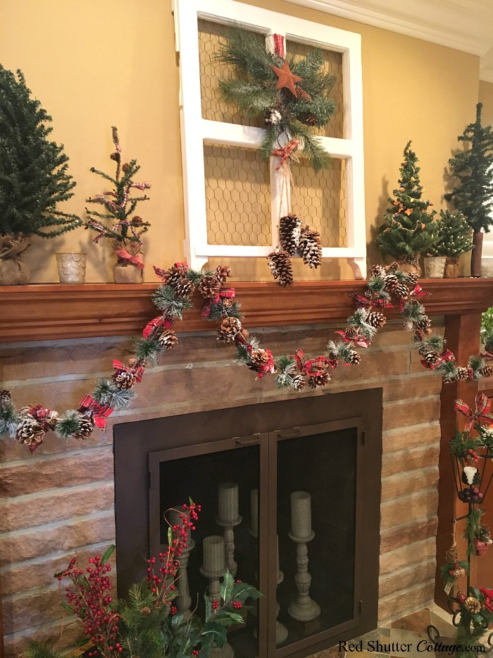 A side view of the mantel and fireplace of the 2018 Christmas Living Room www.redshuttercottage.com