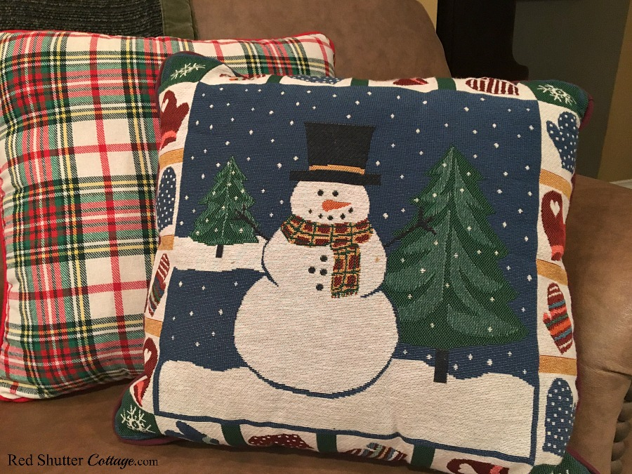 This snowman pillow and plaid pillow are part of the couch display in our 2018 Christmas Living Room. www.redshuttercottage.com