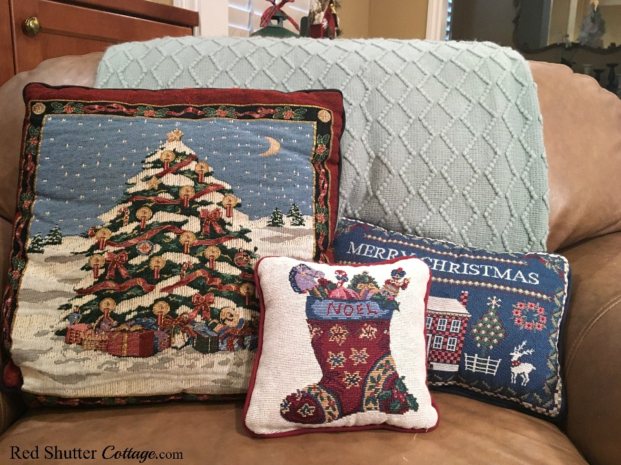 Our 2018 Christmas Living Room includes this chair filled with Christmas pillows. www.redshuttercottage.com