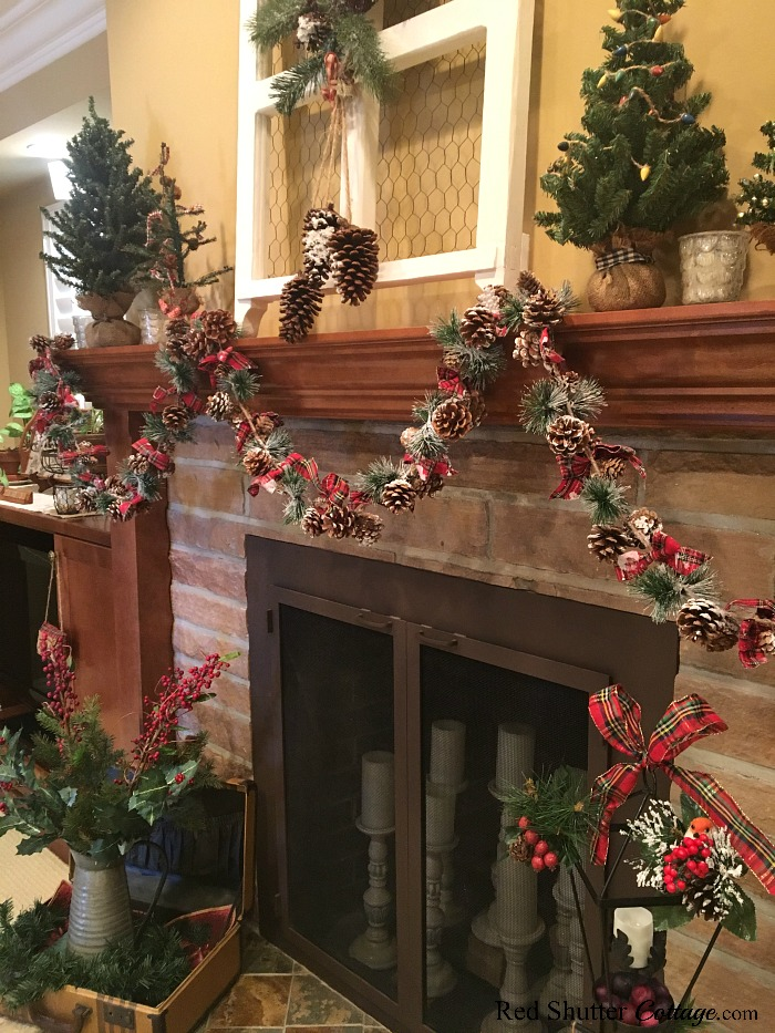 From the right hand side is a view of the candles in the fireplace as part of the 2018 Christmas Living Room. www.redshuttercottage.com