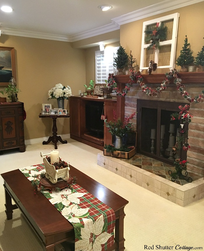A view of the mantel and fireplace, all dressed up for the 2018 Christmas Living Room. www.redshuttercottage.com