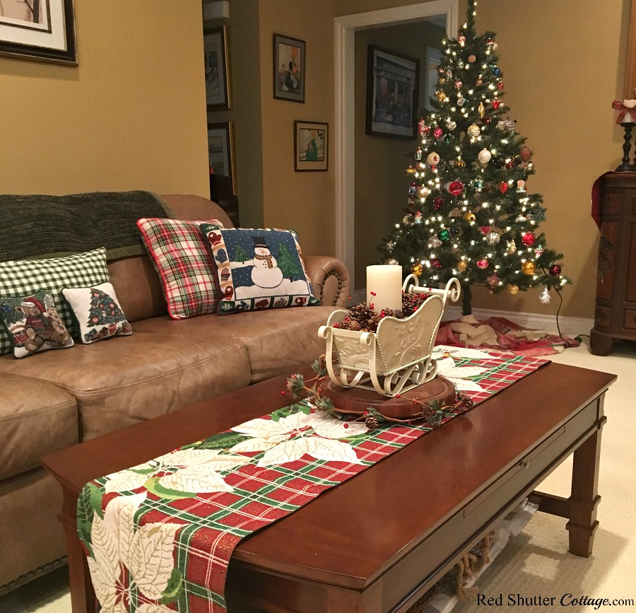 This view of the 2018 Christmas Living Room includes the sleigh on the coffee table and the Christmas tree. www.redshuttercottage.com