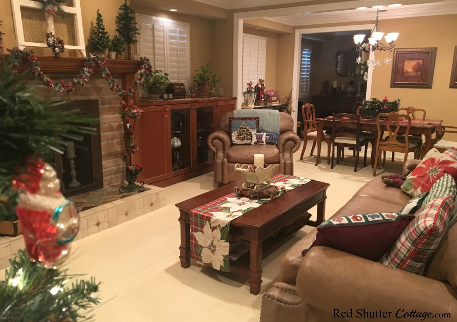 My 2018 Christmas Living Room filled with plaid and pinecones. www.redshuttercottage.com