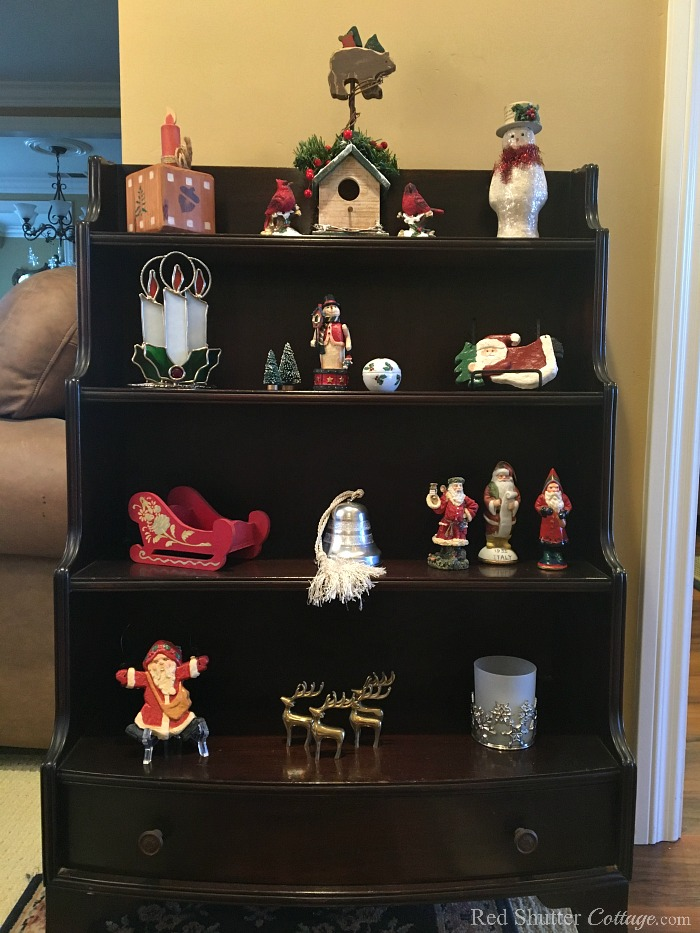This shelf in our entry way shows a few Christmas decorations as part of my 2018 Christmas Living Room. www.redshuttercottage.com