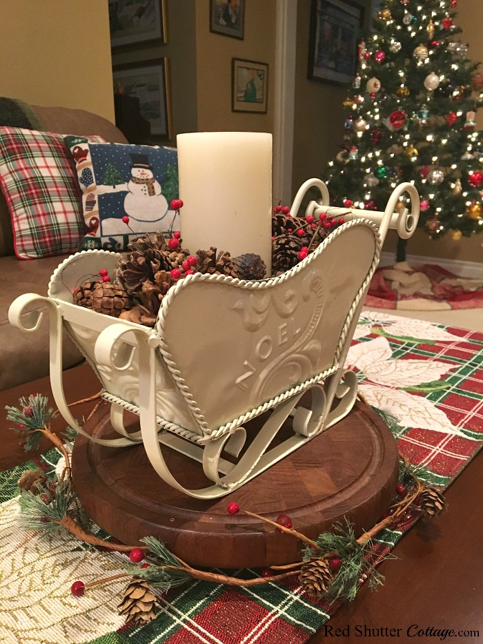 This view of the coffee table sleigh and Christmas tree is part of the 2018 Christmas Living Room. www.redshuttercottage.com