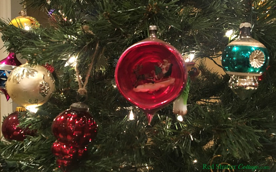 This vintage ornament of Santa in a sleigh is part of the 2018 Christmas Living Room. www.redshuttercottage.com