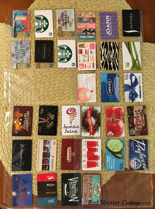 A few dozen gift cards lined up in baseball card protector sheets. Read more here: How to Organize Gift Cards-4 Ideas. www.redshuttercottage.com