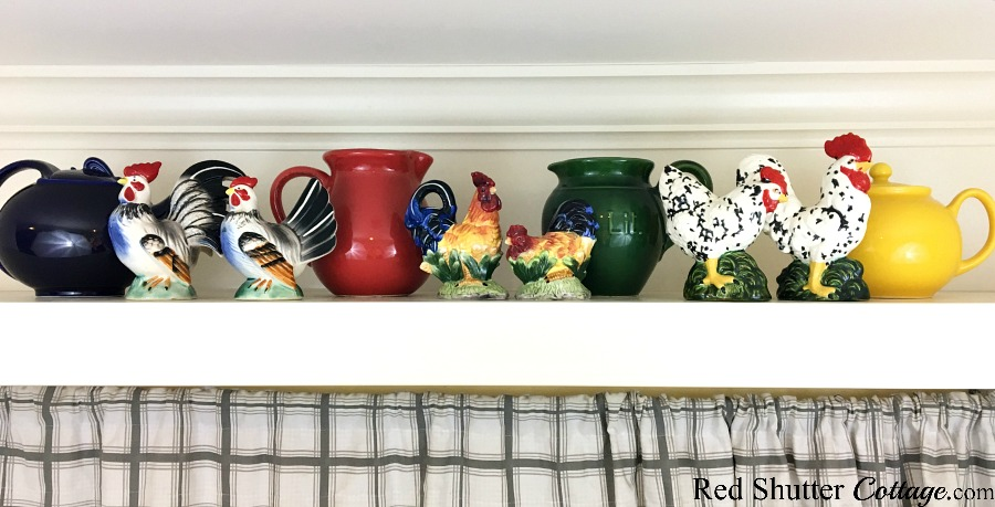 A close up of the full view of the final rooster and pitcher display on 3 Tips for Styling a Kitchen Hutch and Plate Shelf. www.redshuttercottage.com