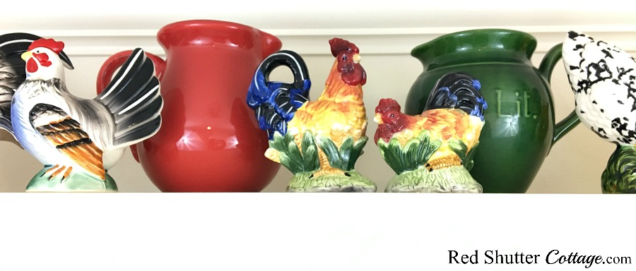 A closer look at the final display of roosters and pitchers, in 3 Tips for Styling a Kitchen Hutch and Plate Shelf. www.redshuttercottage.com