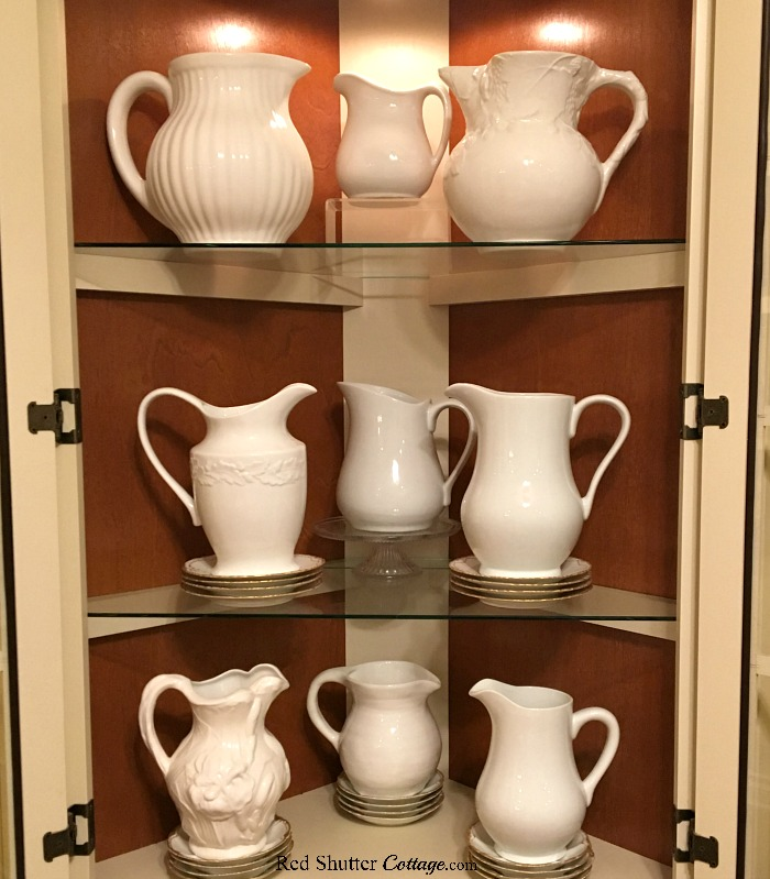 This close up photo shows more details of the white pitchers, which is included in 3 Tips for Styling a Kitchen Hutch and Plate Shelf. www.redshuttercottage.com