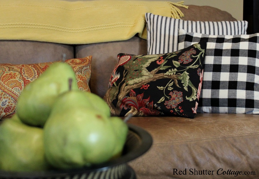 A bit of floral pattern, a few pears, and some pillow ticking and buffalo check pillows in the living room. www.redshuttercottage.com