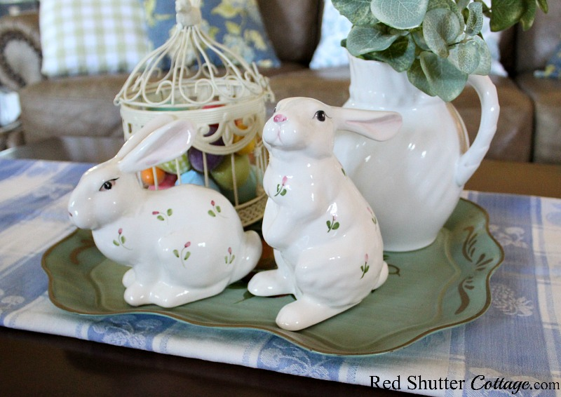 A tolle tray is holding the bunnies and eggs for a Simple & Easy Easter Coffee Table. www.redshuttercottage.com