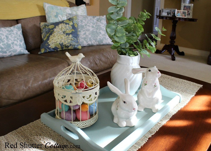 A Simple & Easy Easter Coffee Table includes festively-colored Easter eggs on a turquoise tray. www.redshuttercottage.com