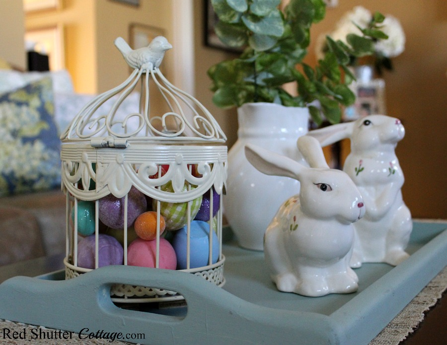 A painted turquoise tray holding all eggs and bunnies for a Simple & Easy Easter Coffee Table. www.redshuttercottage.com