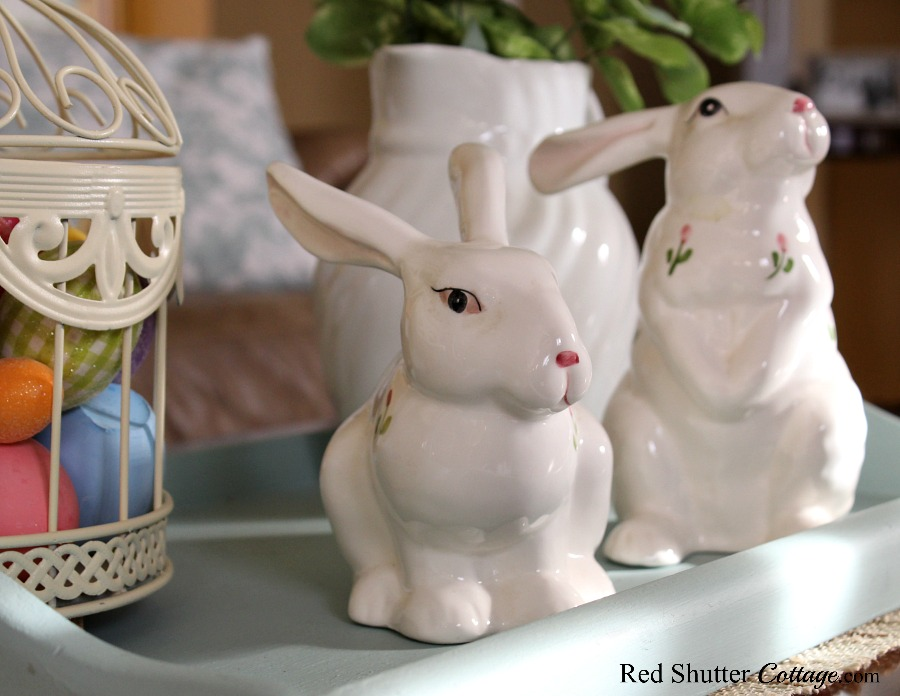 Bunnies from an estate sale are the focal point of a Simple & Easy Easter Coffee Table. redshuttercottage.com