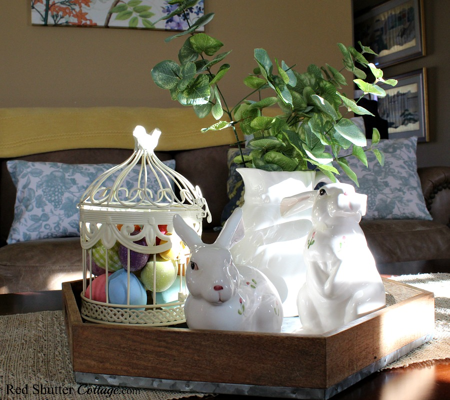 Bunnies in a wooden tray are part of a Simple & Easy Easter Coffee Table. www.redshuttercottage.com