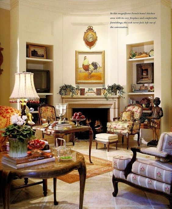 This room is an example of a Traditional style sitting room that includes topiaries, rosters, bowls of fruit, and mixed patterns. This is one of the images of a traditional room as described in How to Mix Up Your Decor Style. www.redshuttercottage.com