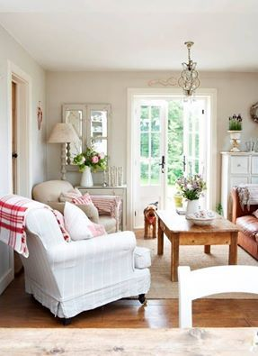 This example of cottage style includes classic wooden floors, sisal rug, and slip covered furniture. This airy, bright living room is part of How To Mix Up Your Decor Style. ww.redshuttercottage.com