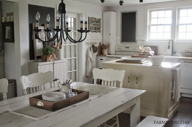 This farmhouse kitchen is soothing and calming with soft, neutral tones of white, small touches of wood, and a little bit of greener, part of How to Mix Up Your Decor Style. www.redshuttercottage.com