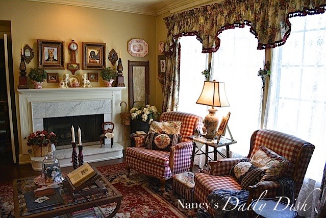 A mixture of floral fabrics, buffalo check and needle point make this Traditional room feel cozy and well-lived in. www.redshuttercottage.com