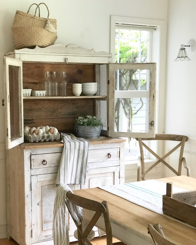 A farmhouse kitchen complete with a hutch and kitchen table. www.redshuttercottage.com