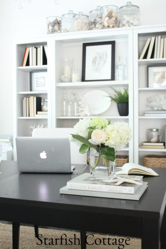Shells and coral dress-up this office with a definite coastal feel, part of How to Mix Up Your Decor Style. www.redshuttercottage.com