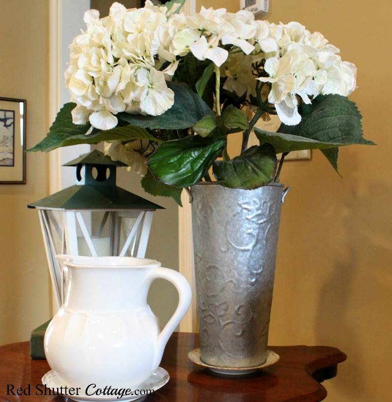 This French flower bucket was a garage sale find, even before I knew what it was. It's part of Hydrangeas in the Summer Living Room, along with a Williams Sonoma pitcher and a lantern. www.redshuttercottage.com