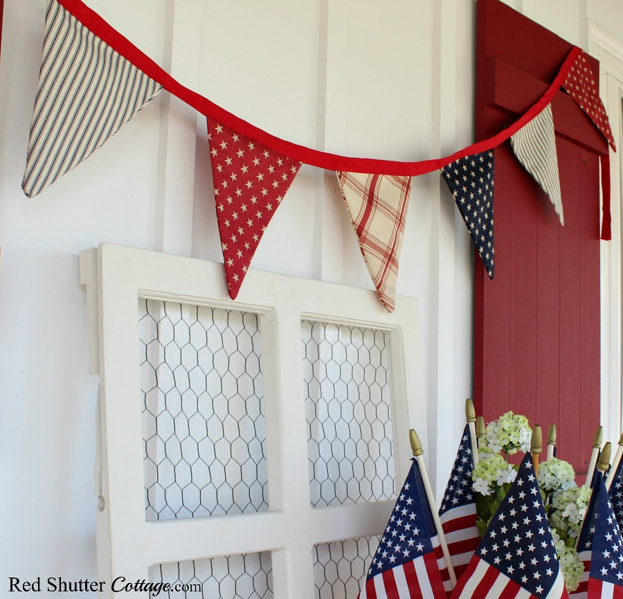 A banner of red, white and blue helps with the festive feel of 4th of July On The Front Porch.