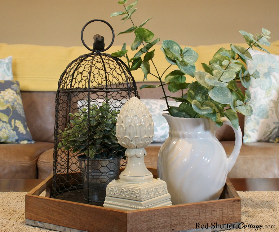A coffee table vignette of summery colors, part of Hydrangeas in the Summer Living Room. www.redshuttercottage.com