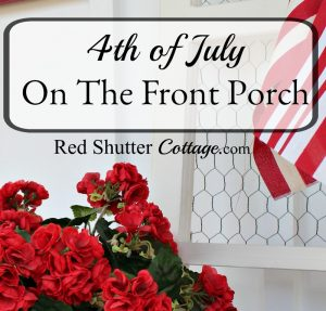 A fun and easy 4th of July On The Front Porch, using flower, banners and flags.