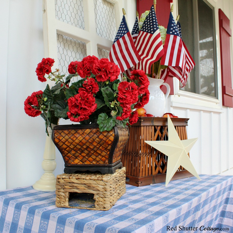 The final display of 4th of July On The Front Porch includes only 1 pitcher holding flags and hydrangeas.