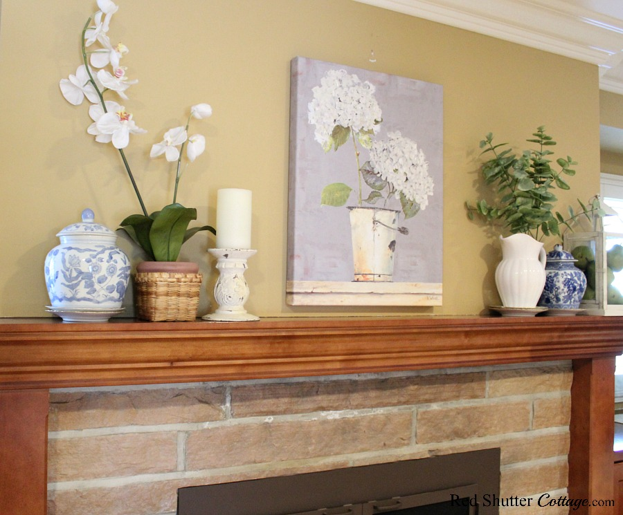 The hydrangea print combined with a chippy candleholder and some greenery are part of Hydrangeas in the Summer Living Room. www.redshuttercottage.com