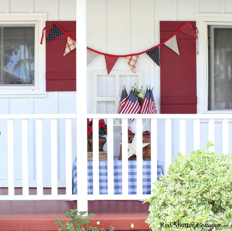 A view of 4th of July On The Front Porch as seen from the garden.