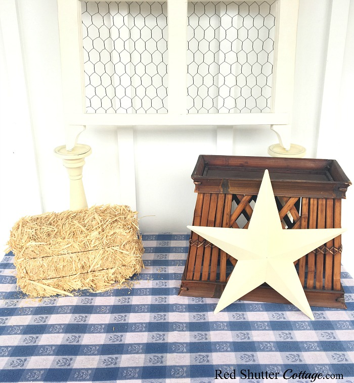 An old window frame and oversized star bring some holiday spirit to 4th of July On The Front Porch.