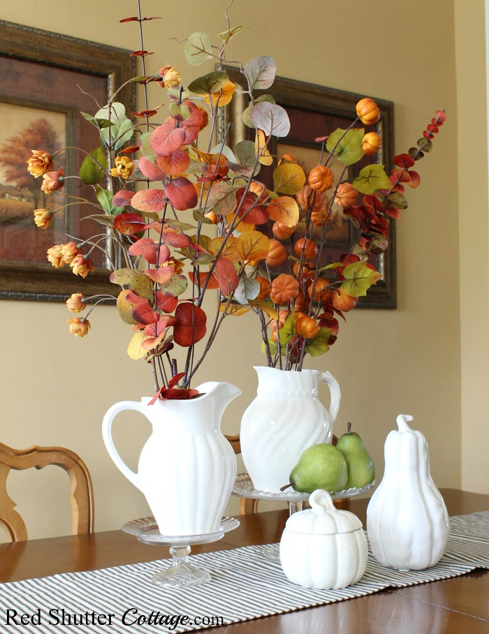 Cake plates help with elevating the fall look of white pitchers and green pears that are part of 2019 Bright & Airy Fall Living Room. www.redshuttercottage.com