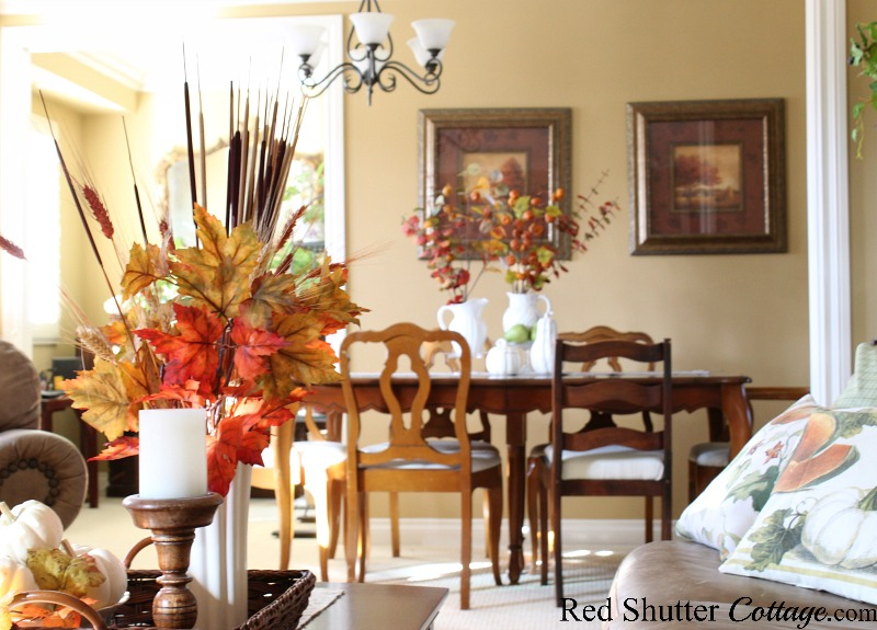 Fall vignettes on both the coffee table and on the dining table are included in the 2019 Bright & Airy Fall Living Room. www.redshuttercottage.com