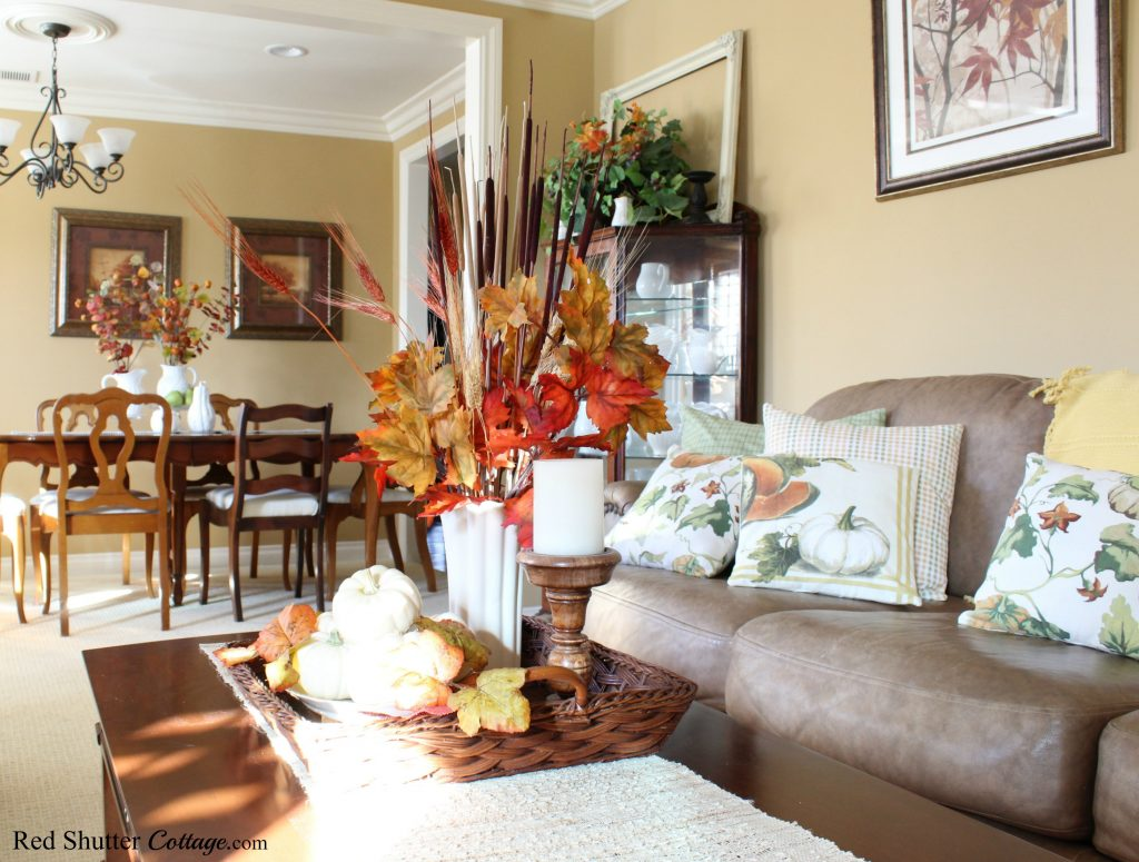 Looking back towards the dining room shows the range of fall foliage and pumpkins as part of the 2019 Bright & Airy Fall Living Room. www.redshuttercottage.com