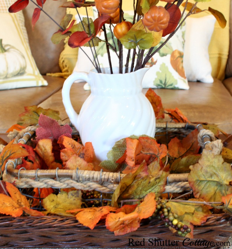 Here are two baskets, nested together, and then filled with fall leaves and berries, all part of A Fall Coffee Table - 3 Ways. www.redshuttercottage.com