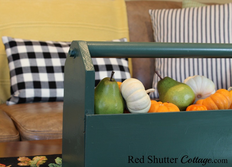A tool tote filled with a tumble of pumpkins and pears is part of A Fall Coffee Table - 3 Ways. www.redshuttercottage.com