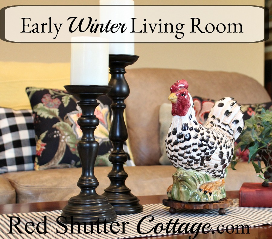 This Early Winter Living Room includes two different coffee table vignettes, rich colors on the couch, and a simply dressed fireplace and hearth. www.redshuttercottage.com
