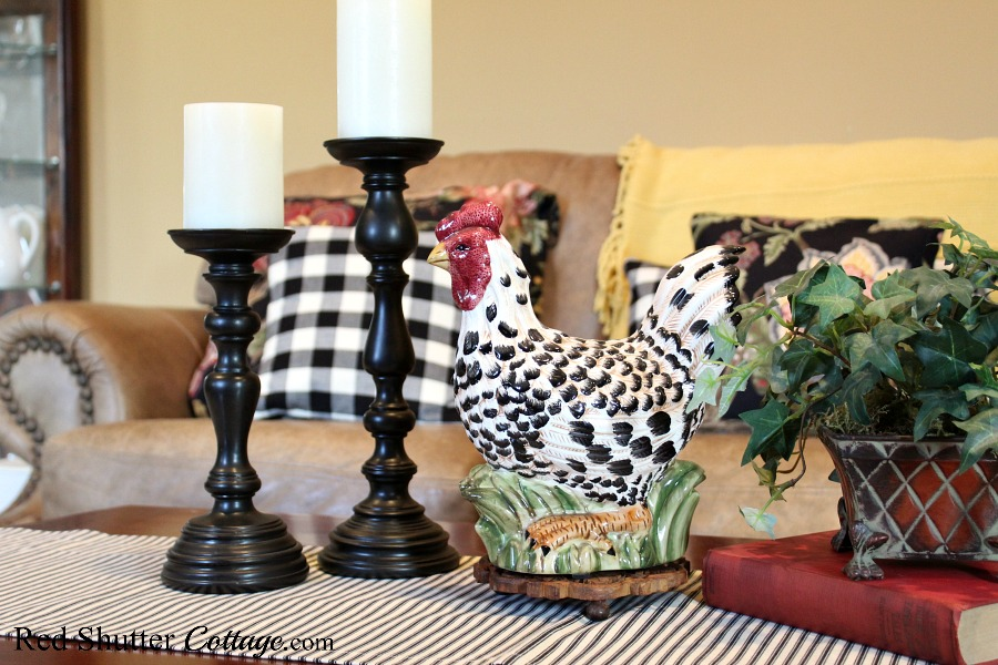 This rooster with his back and white feathers fits in perfectly with the black and white runner and buffalo check pillow in the Early Winter Living Room. www.redshuttercottage.com