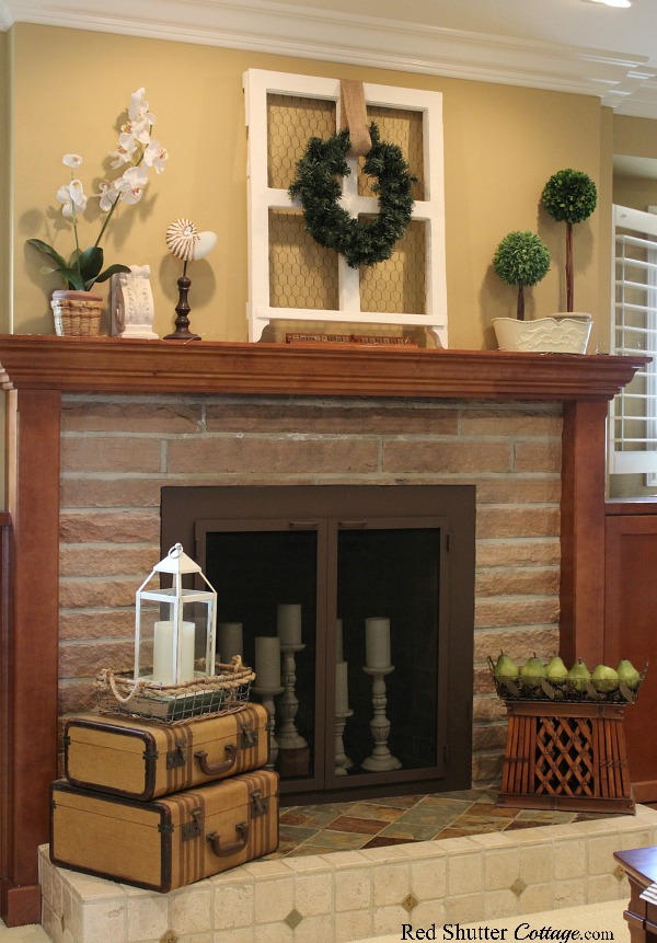 A simple fireplace helps create a warm and welcoming feel in the Early Winter Living Room. www.redshuttercottage.com